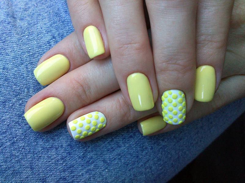 Embossed yellow nail polish